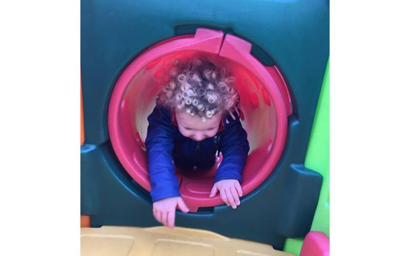 Child going through a tunnel