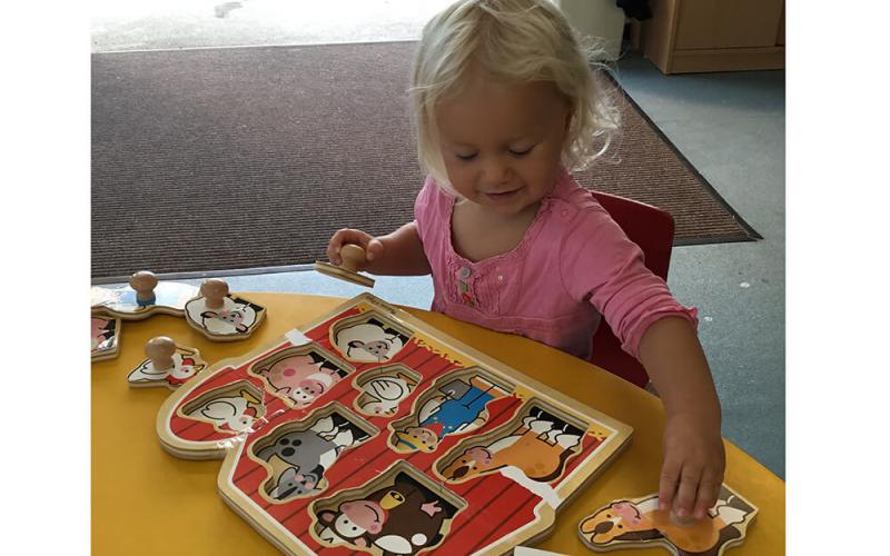 Child with animal jigsaw