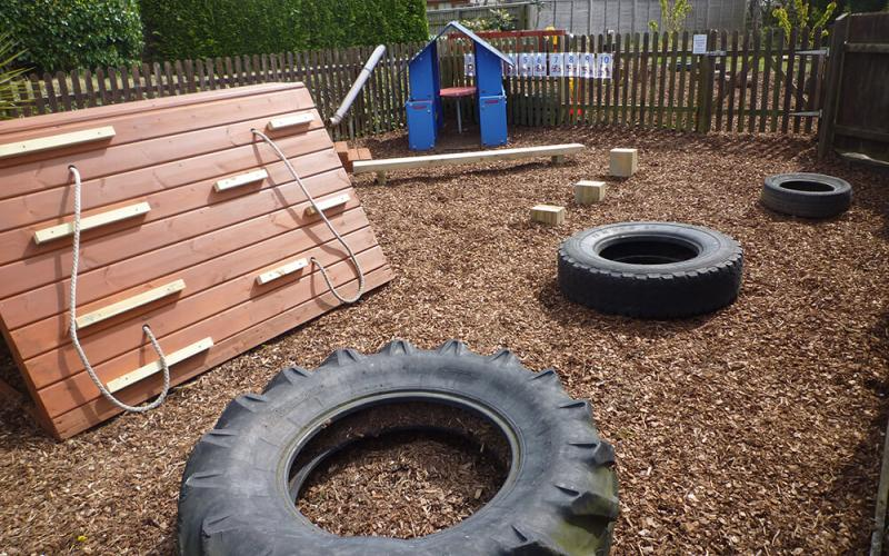 Outdoor play area with tyres